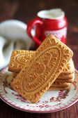 Assorted cookies with a pot of milk for breakfast or snack, selective focus — Stock Photo
