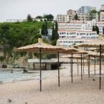 Empty beach with umbrellas, Budva, Montenegro — Stock Photo #57542557