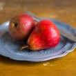 Freshly harvested red pears on a plate — Stockfoto #57596817