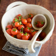 Freshly harvested cherry tomatoes in a large bowl prepared to be used for sauce or ketchup — Stock Photo #59986639