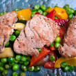 Roasted pork fillet meat with frozen peas — Stock Photo #60966213