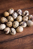 Quail eggs on the wooden vintage table, selective focus — Stock Photo