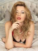 Beautiful Young Pin Up Model Posing on a Bed — Stock Photo