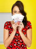 Attractive Young Woman Holding Money — Stock Photo