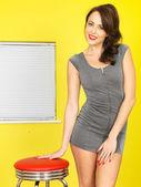 Happy Young Woman Wearing a Short Grey Mini Dress — Stock Photo