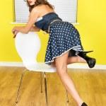 Young Woman Wearing a Blue Polka Dot Mini Dress — Stock Photo #55185315