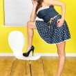 Young Woman Wearing a Blue Polka Dot Mini Dress — Stock Photo #55185631