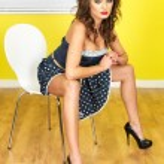 Young Woman Wearing a Blue Polka Dot Mini Dress — Stock Photo