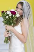 Attractive Young Bride Carrying Flowers — Stockfoto