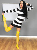 Sexy Young Woman Wearing a Mini Dress and Yellow Stockings — Stock Photo