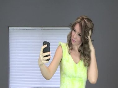 Attractive Young Using a Cell Phone Taking a Selfie — Stock Video