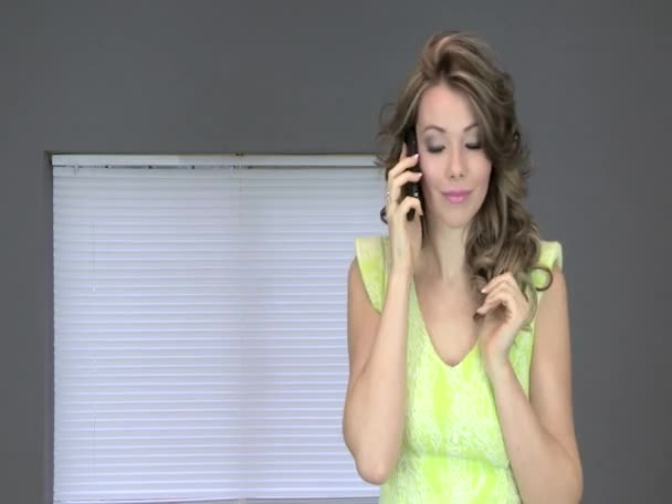 Attractive Young Using a Cell Phone — Vidéo