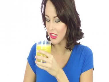Young Woman Drinking a Glass of Fresh Orange Juice — Stock Video