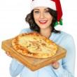 Young Woman in Santa Hat Holding a Cooked Pizza — Stock Photo #58939483