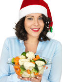 Young Woman in Santa Hat Holding Bowl of Cooked Mixed Vegetables — Stock Photo