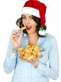 Young Woman in Santa Hat Holding Bowl or Cooked Roast Potatoes — Fotografia Stock