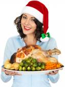 Young Woman in Santa Hat Holding Roast Turkey and Vegetables — Stock Photo