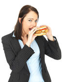 Young Business Woman Eating a Chicken Burger — Stock Photo