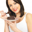 Young Woman Eating Chocolate Cake — Stock Photo #59170609