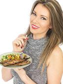 Young Woman Eating Mackerel and Salad — Stock Photo