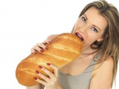 Young Woman Holding a Loaf of White Bread — Stock Photo