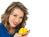 Happy Young Woman Holding a Fresh Ripe Juicy Mango — Stock Photo