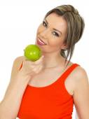 Young Woman Holding a Fresh Ripe Green Apple — Stock Photo