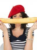 Attractive Young Woman Eating a French Stick Bread Loaf — Stok fotoğraf