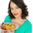 Young Woman Eating Saveloy Sausage and Chips — Stock Photo #68179295