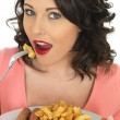 Young Woman Eating Jumbo Sausage and Chips — Stock Photo #68189865