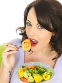 Young Woman Eating a Healthy Mixed Salad — Stock Photo