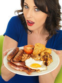 Young Woman Eating a Full English Breakfast — Stock Photo