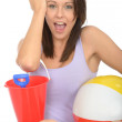 Portrait of a Happy Excited Young Woman Holding a Bucket and Spade — Stock Photo #71736703