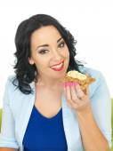 Healthy Woman Eating a Cracker with Peanut Butter and Sliced Banana — Zdjęcie stockowe