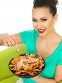 Beautiful Attractive Young Hispanic Woman With Cheesy Nachos and a Spicy Salsa Sauce — Stock Photo