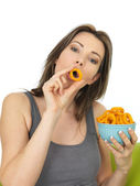 Attractive Young Woman Holding a Bowl of Onion Ring Flavoured Snacks — Stock Photo