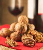 Walnuts and red wine — Stock Photo