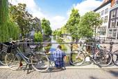 A man sitting down in one bridge of Utrecht, Netherlands — Stock Photo