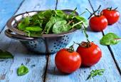 Tomatoes and green lettuce — Stock Photo