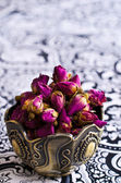 Dried rose buds in a metal Cup — Stock Photo