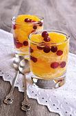 Dessert of orange slices and berries cranberries — Stock Photo