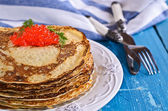 A stack of pancakes with red caviar — Stock Photo