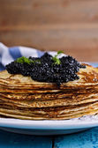 A stack of pancakes with black caviar — Stock Photo