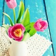 Pink tulips in a vase — Stock Photo #67056517