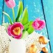 Pink tulips in a vase — Stock Photo #67065927