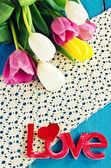 """Tulips of different colors and the words """"love"""" — Stock Photo"""
