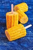 Cut corn on the cob on a stick — Stock Photo