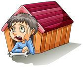 A boy inside the doghouse — Stock Vector