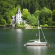 The Grundlsee lake with beautiful castle and sailboat. — Stock Photo #65962811