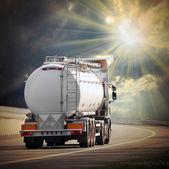 White tanker truck on the highway. — Stock Photo
